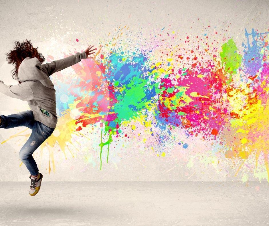 child dancing by street art